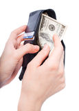 Hands taking money from open wallet Stock Photo