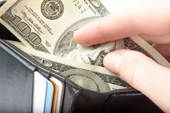 Hands taking money from open wallet Royalty Free Stock Photos