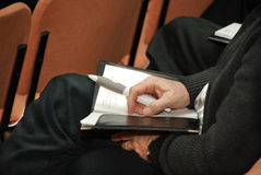 Hands taking notes. On conference Royalty Free Stock Photos