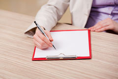 The hands taking notes in the pad Royalty Free Stock Photos