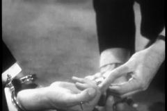 Hands taking off ring from finger of man in handcuffs stock video footage
