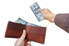 Hands taking out cash Royalty Free Stock Photography