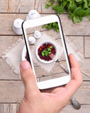 Hands taking photo beet salad with smartphone Stock Images