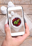 Hands taking photo beet salad with smartphone Stock Photos
