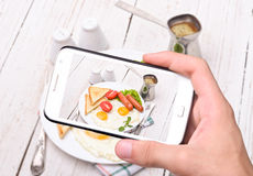 Hands taking photo breakfast with smartphone Royalty Free Stock Photos