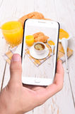 Hands taking photo breakfast with smartphone Royalty Free Stock Images