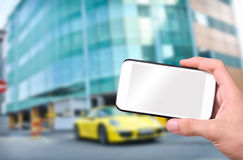 Hands taking photo car with smartphone. Royalty Free Stock Image