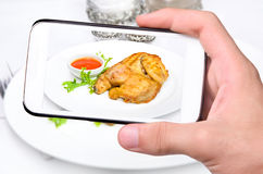 Hands taking photo chicken with smartphone Stock Photo