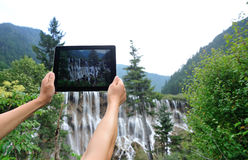 Hands taking photo with digital tablet Royalty Free Stock Photos