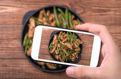 Hands Taking Photo Homemade Chicken With Asparagus With Smartphone. Stock Photography
