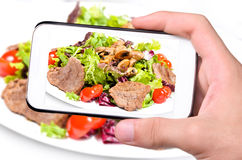 Hands taking photo meat with smartphone Stock Photo