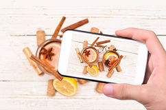 Hands taking photo mulled wine with smartphone Stock Photos