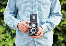 Hands taking photo with TLR camera Stock Photography