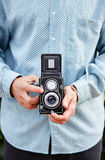Hands taking photo with TLR camera Royalty Free Stock Image