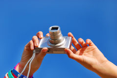 Hands taking photos by digital camera Royalty Free Stock Photo