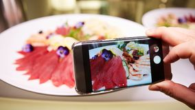 Hands taking picture of sashimi japan food with smartphone. Hands taking picture of sashimi japan food with smartphone Royalty Free Stock Image