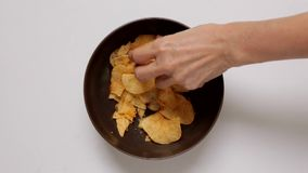 Hands Taking Potato Chips stock footage
