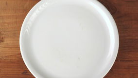 Hands taking sweet donuts from the plate and put them back stock video
