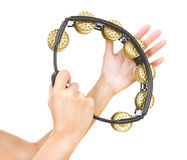 Hands with a tambourine (hands play the tambourine). Tambourine is in hands isolated on a white background Royalty Free Stock Image