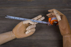Hands and Tape measure Royalty Free Stock Photo