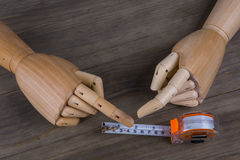 Hands and Tape measure Stock Photos