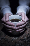 Hands with tea cup Royalty Free Stock Photos