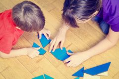 Hands of teacher and child playing with geometric Royalty Free Stock Photography
