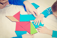 Hands of teacher and child playing with geometric Royalty Free Stock Images