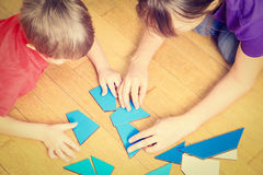 Hands of teacher and child playing with geometric Stock Image