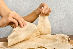 Hands tear off a piece of pita bread, closeup Royalty Free Stock Image