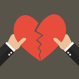 Hands tearing apart heart symbol Royalty Free Stock Image