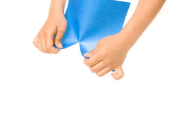 Hands Tearing Blue Paper Royalty Free Stock Images