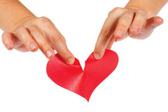 Hands tearing paper red heart Stock Image