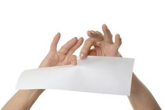 Hands tearing paper Stock Image