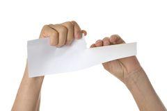Hands tearing paper sheet Stock Image
