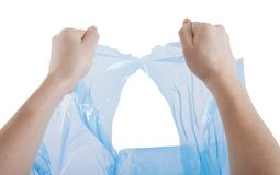 Hands tearing a plastic bag Stock Photography