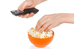 Hands a teenager with popcorn and remote control Royalty Free Stock Photos