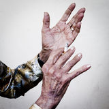 Hands that tell stories. Hands of an old woman with sigarette Stock Images