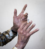 Hands that tell stories. Hands of an old woman with sigarette Stock Photography
