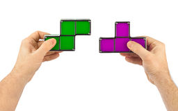 Hands with tetris toy blocks Stock Photo