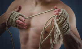 Hands Thai boxer. Close-up of a young Thai boxer hands hemp ropes are wrapped before the fight or training Stock Photography