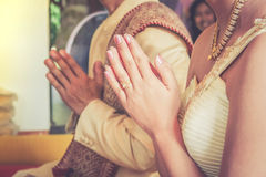 Hands of Thai groom and bride pray to the monk Royalty Free Stock Image