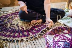 Hands of Thai woman knitting a mat Royalty Free Stock Photos