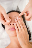 Hands threading beautiful womans eyebrow Royalty Free Stock Photo