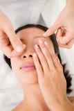 Hands threading beautiful womans eyebrow Royalty Free Stock Photo