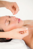 Hands threading beautiful womans face. Close up view of hands threading beautiful womans face Royalty Free Stock Photos