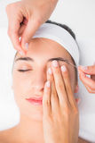 Hands threading beautiful womans upper eyes Royalty Free Stock Photos