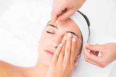 Hands threading beautiful womans upper eyes Royalty Free Stock Photography