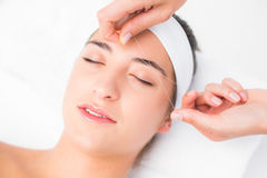Hands threading beautiful womans upper lip Stock Photo