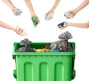 Hands throw garbage into a trash can on a white. Recycle concept. Hands throw garbage into a trash can on a white background stock images